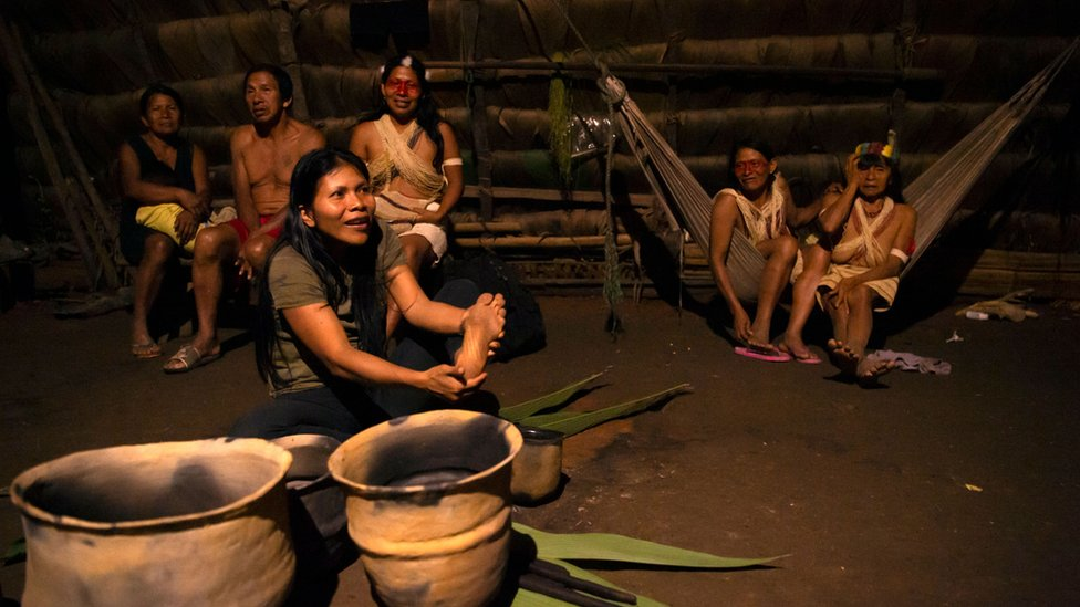 Waorani at a house in the village of Nemompare, on the banks of the Curaray river, in Pastaza province, Ecuador on April 14, 2019.
