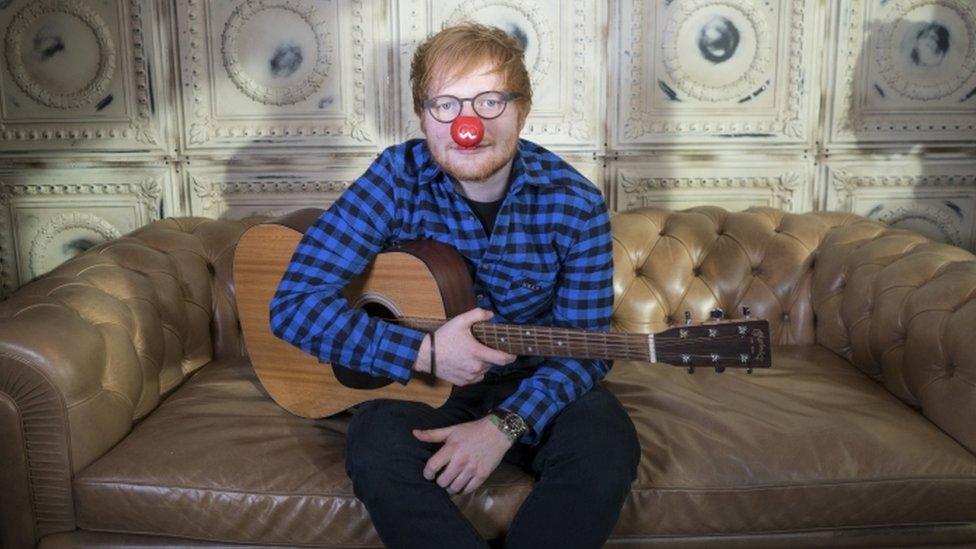 Ed Sheeran wears a red nose