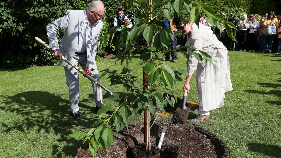 Ana's parents plant a tree in her memory during a special ceremony the Leixlip Manor Hotel in County Kildare