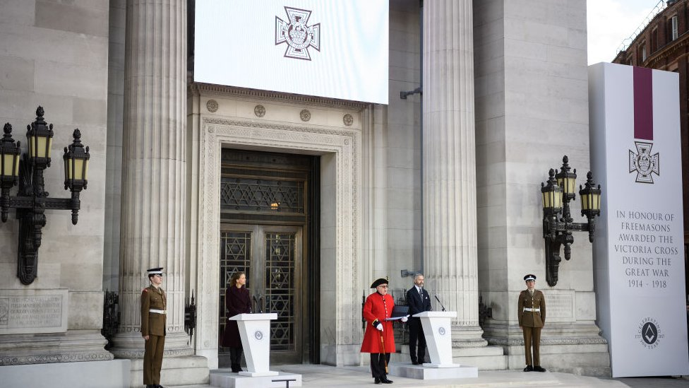 A monument commemorating those who were awarded the Victoria Cross medal is unveiled outside the Freemasons' Hall in London