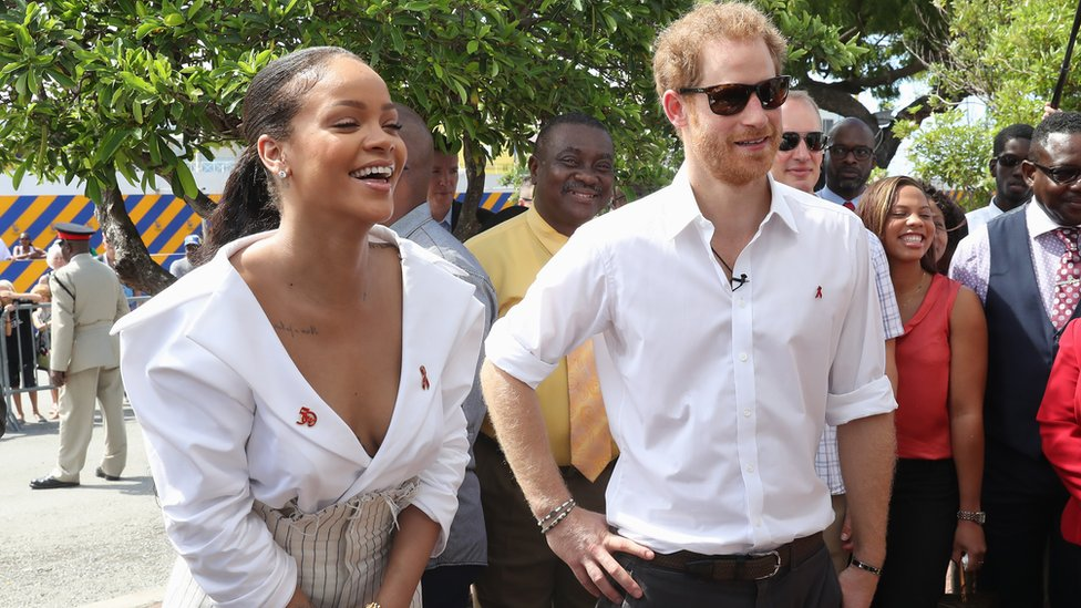 Rihanna laughs, standing next to Prince Harry at awareness event in Barbados