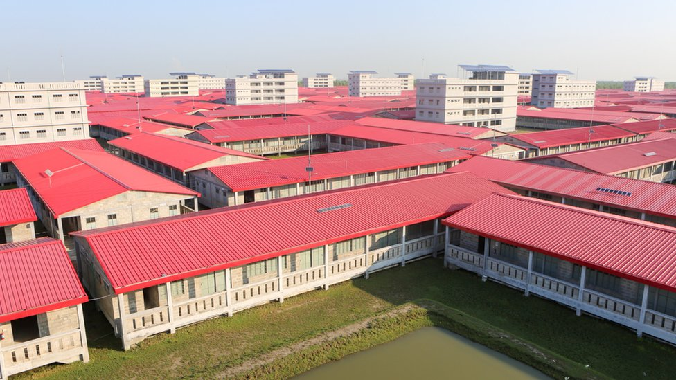 A bird's eye view of the red roofed houses. Started in 2018, a total 1440 homes have been built with adjacent kitchens and bathrooms to be shared between several families