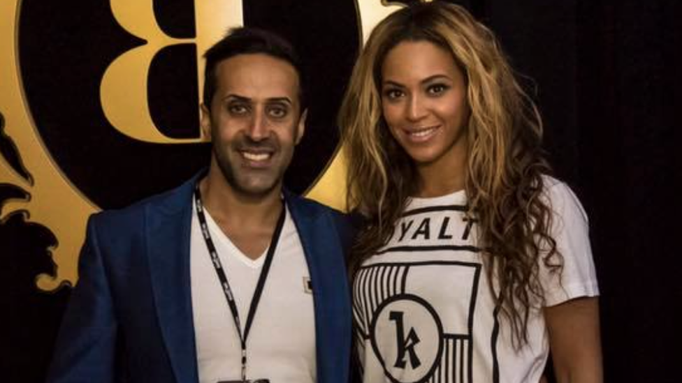 Manni Hussain posing with Beyonce