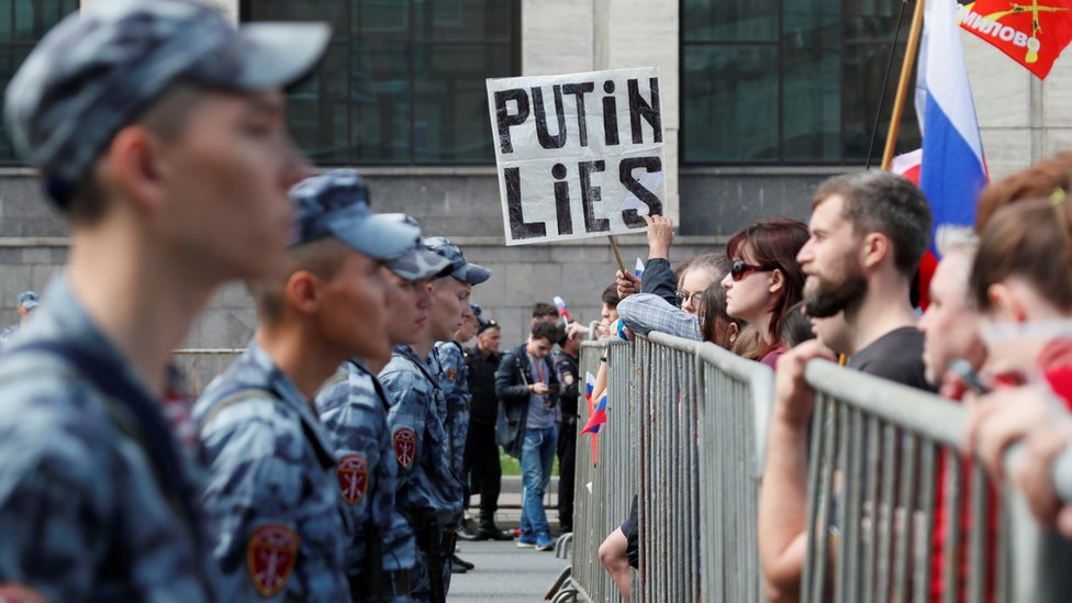 Russia's National Guard watch protesters during the rally