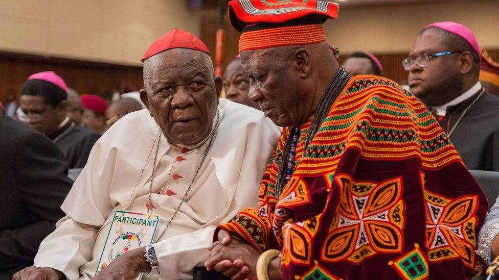 Cardinal Christian Wiyghan Tumi (L) talks with Cameroonian veteran opposition leader John Fru Ndi
