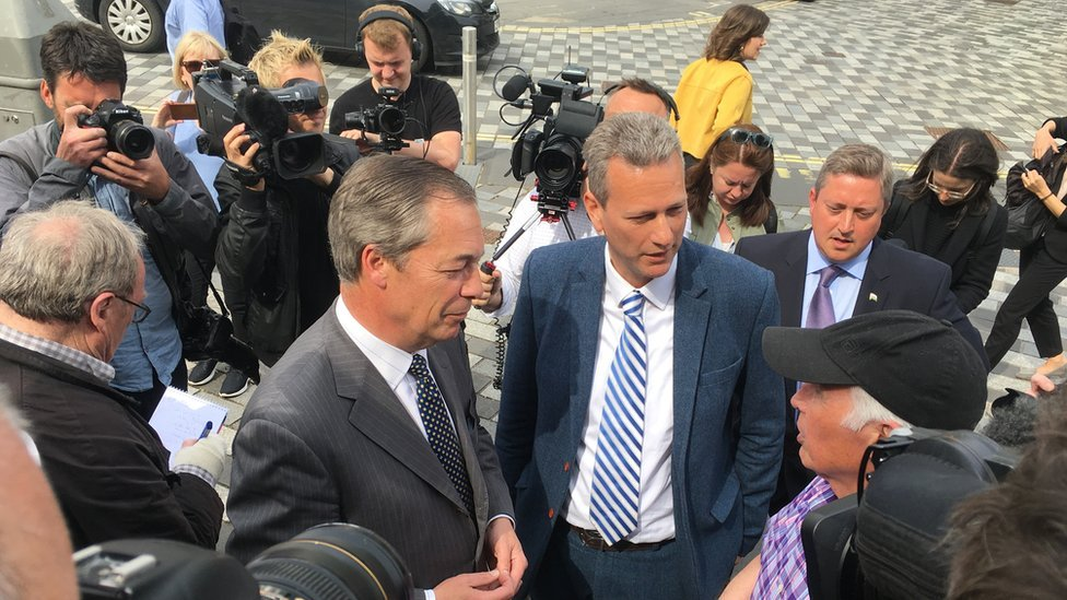 Nigel Farage and Nathan Gill meeting voters in Merthyr Tydfil in May 2019