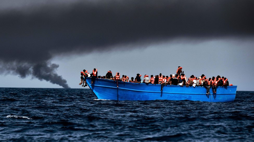 Migrants wait to be rescued in the Mediterranean Sea