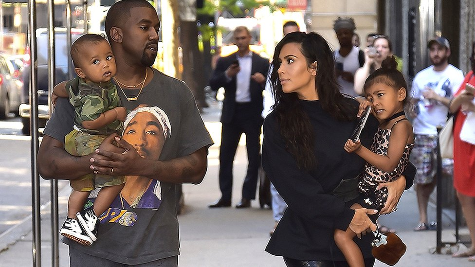 Kanye West and Kim Kardashian with children Saint and North
