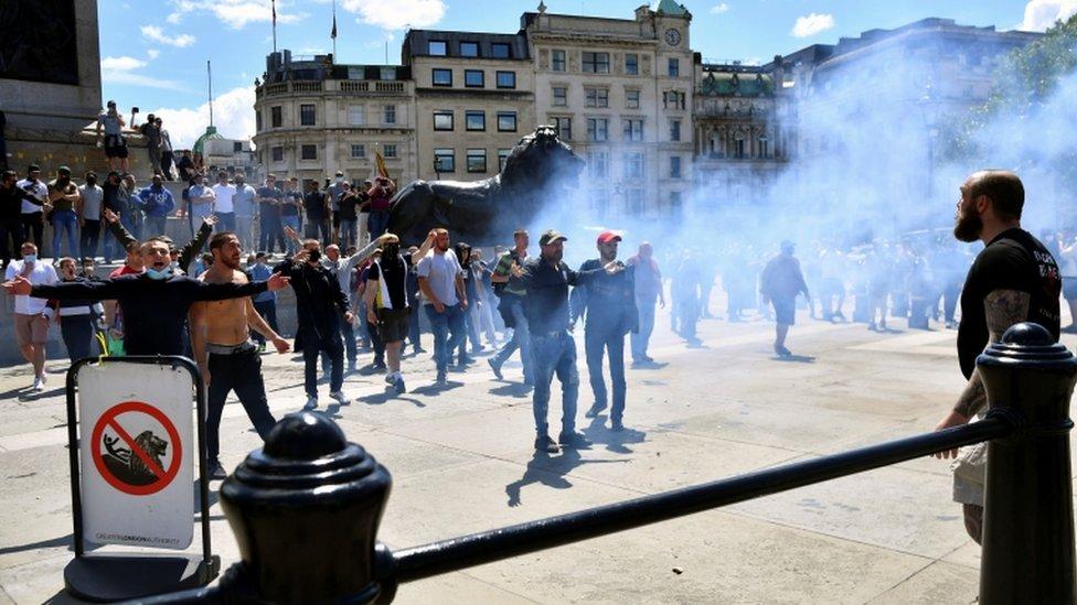 Flares and smoke bombs were thrown in Trafalgar Square