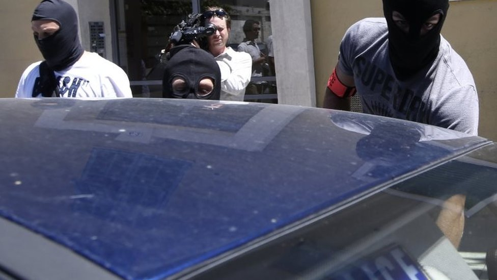 Hooded French police officers were pictured leaving the Nice address of the attacker Lahouaiej-Bouhlel on Saturday