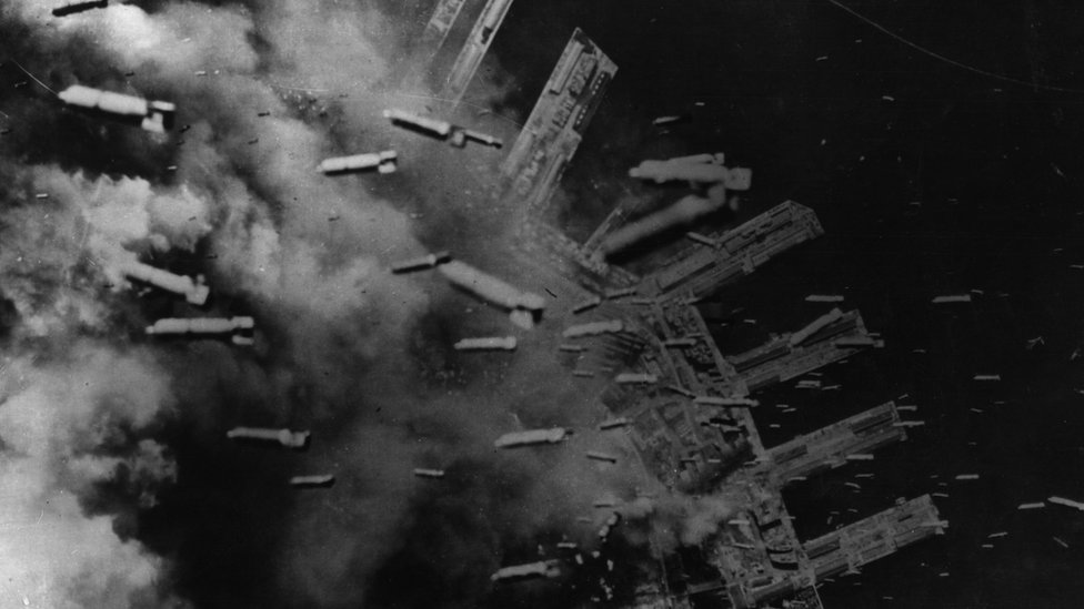 3000 tons of incendiary bombs drop on Japanese positions in the dock area of Kobe