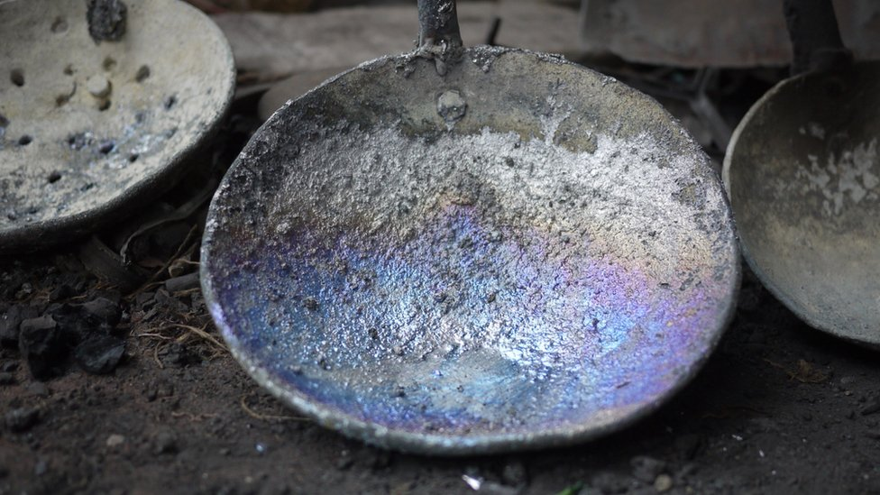A utensil corroded by lead at a lead acid battery recycling factory in Patna, in India's Bihar state.