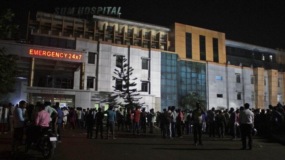 People gather outside Sum Hospital in Bhubaneswar, India. Photo: 17 October 2016
