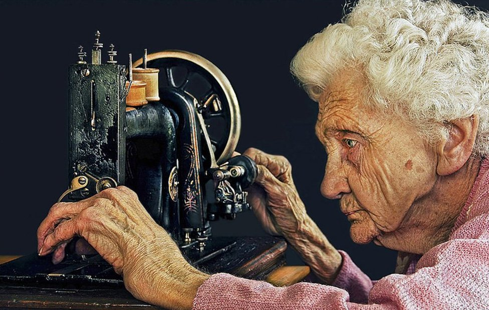 91 year old woman adjusting her sewing machine