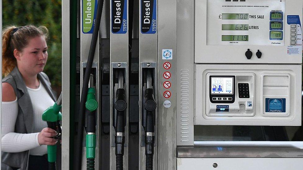 Woman at petrol station