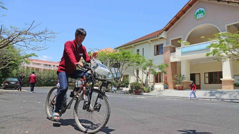 A student riding a bike