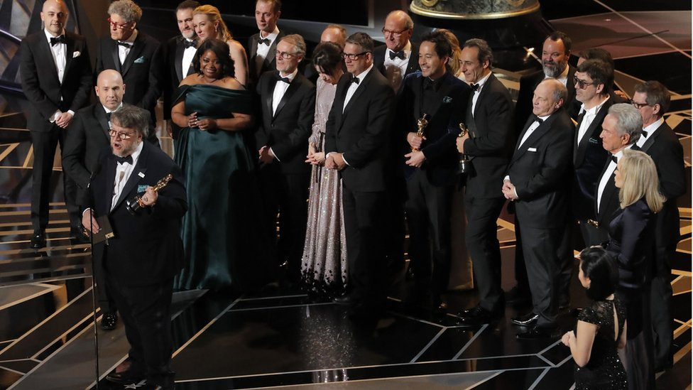 The Shape of Water cast and crew accepting the award for best picture