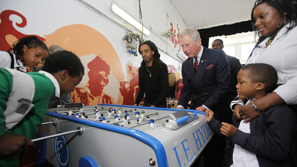 Prince Charles plays table football with children at Kids Company, 2009