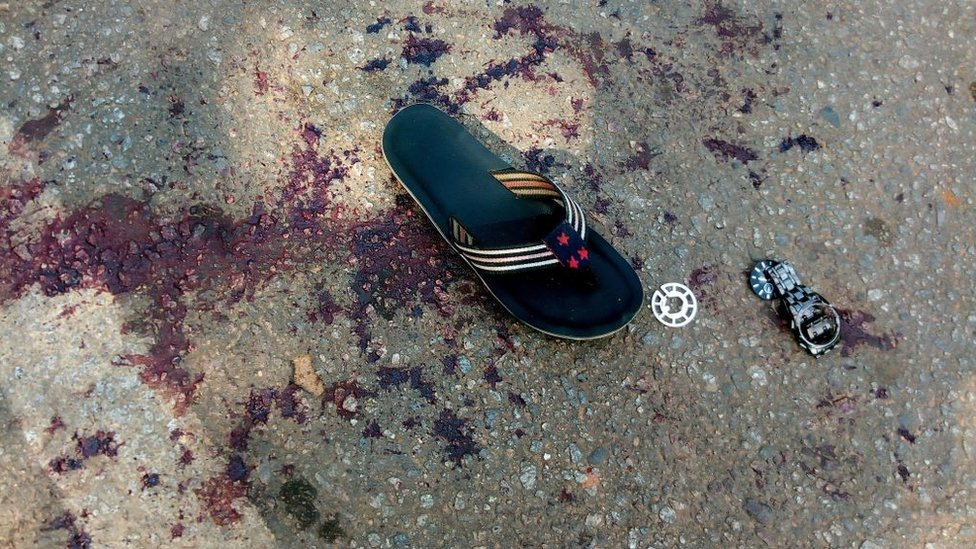 A shoe sits on blood stained floor following the clash between security operatives and supporters of an imprisoned leader of the Islamic Movement of Nigeria (IMN) Ibrahim Zakzaky at the premises of national assembly building in Nigeria's capital Abuja, on July 9, 2019.