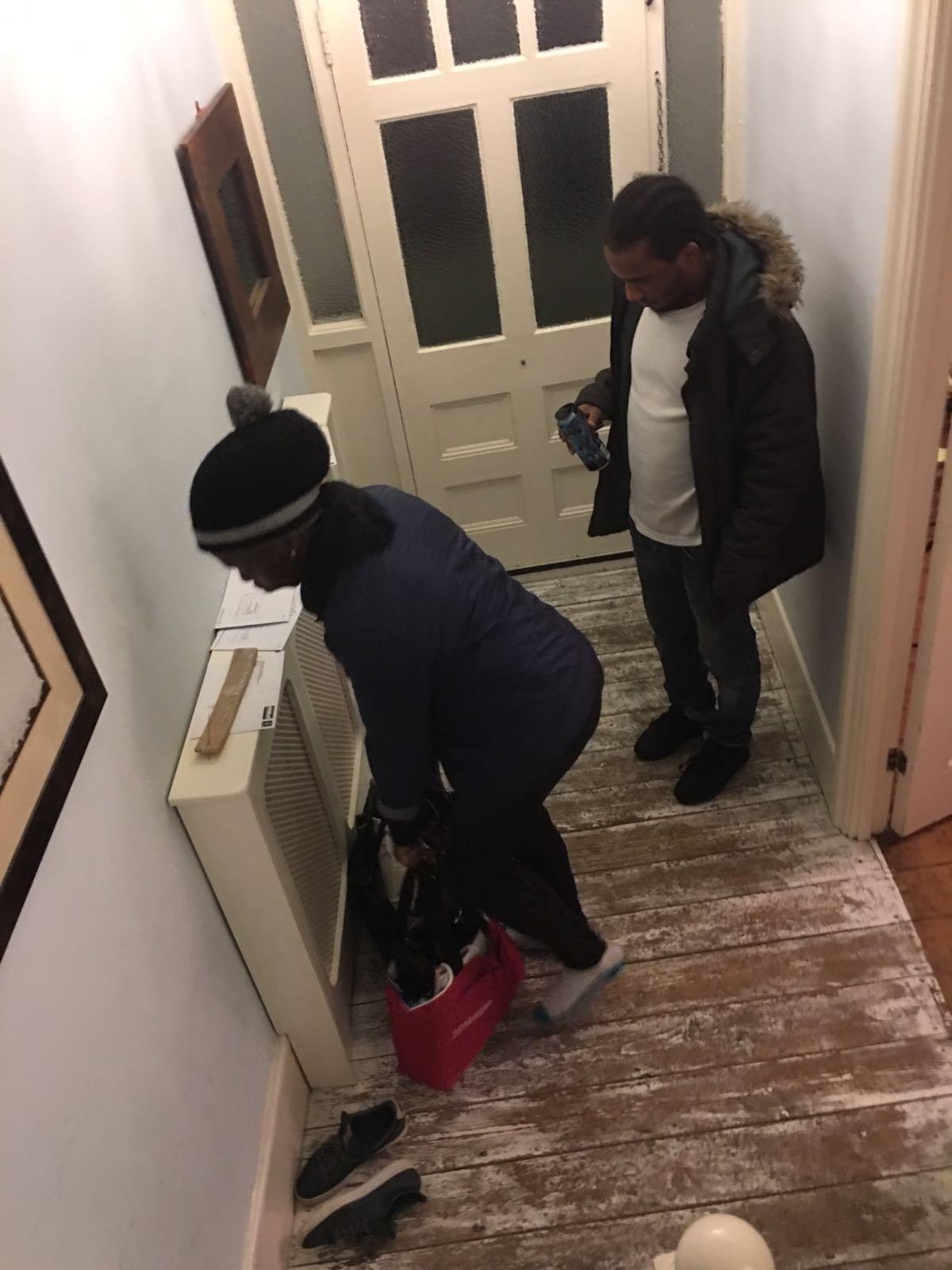 Matovu and Dunbar leave house of a victim