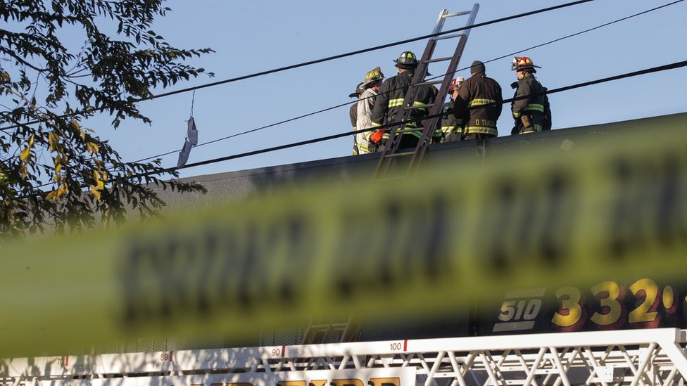 Firefighters investigate the scene of a overnight fire that claimed the lives of at least nine people at a warehouse in the Fruitvale neighborhood on 3 December, 2016