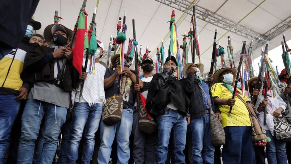 "Indigenous protesters raise their batons during a symbolic ""impeachment"" of President Iván Duque in Bogotá. Photo: 19 October 2020"