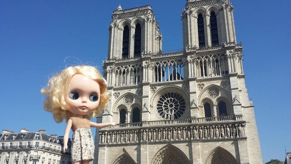 Blythe doll in front of Notre Dame