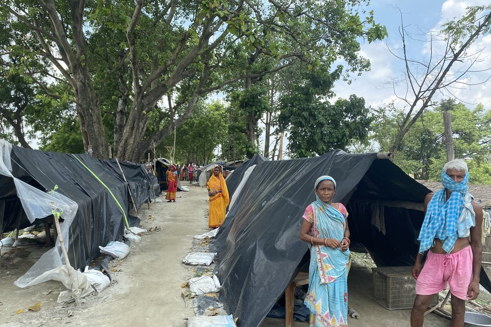 Tents crowd the embankment near Bhawanipur