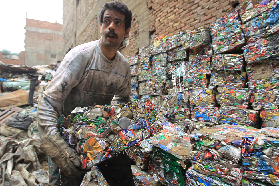 An Egyptian garbage collector works in the impoverished Al-Zabbalin area in Al-Mukatam neighbourhood in the Egyptian capital Cairo on April 20, 2010