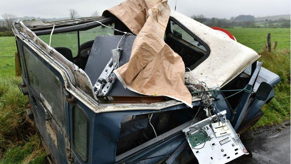 Damaged vehicle with machine