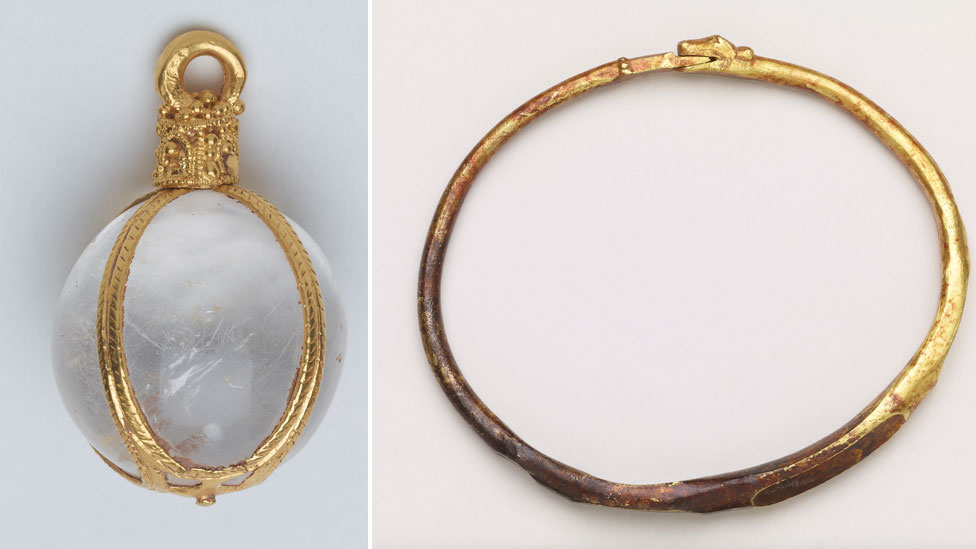 Close-up views of the crystal pendant and the arm-ring