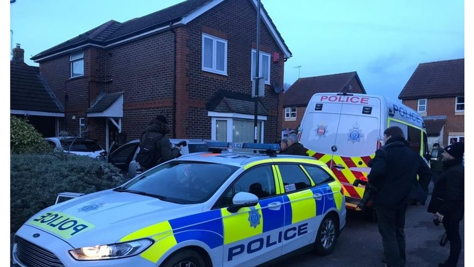 Police search a house in Crawley