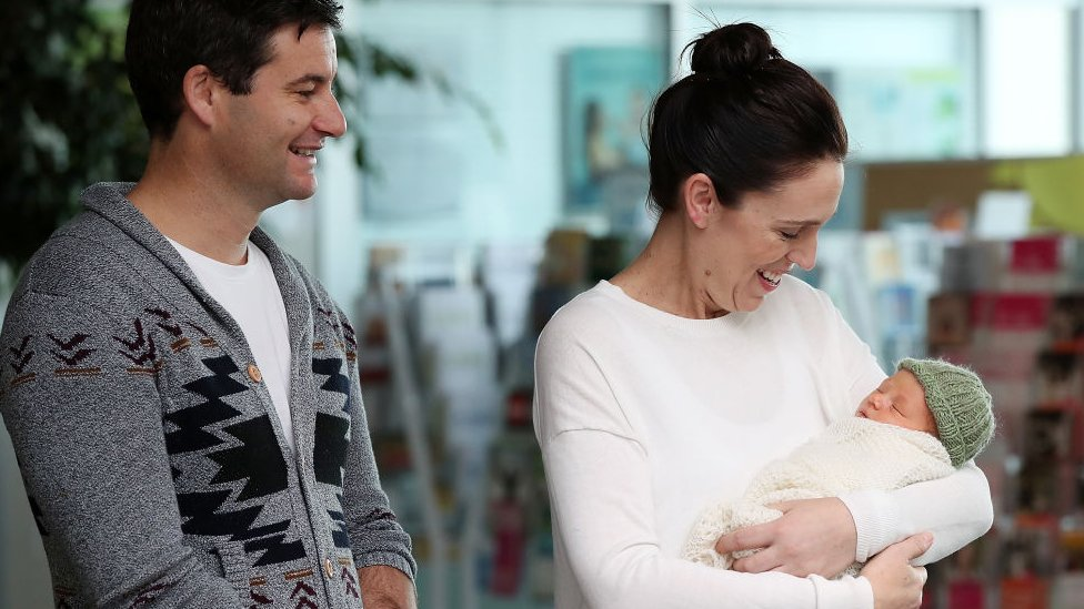 New Zealand Prime Minister Jacinda Ardern and partner Clarke Gayford pose for a photo with their new baby girl Neve Te Aroha