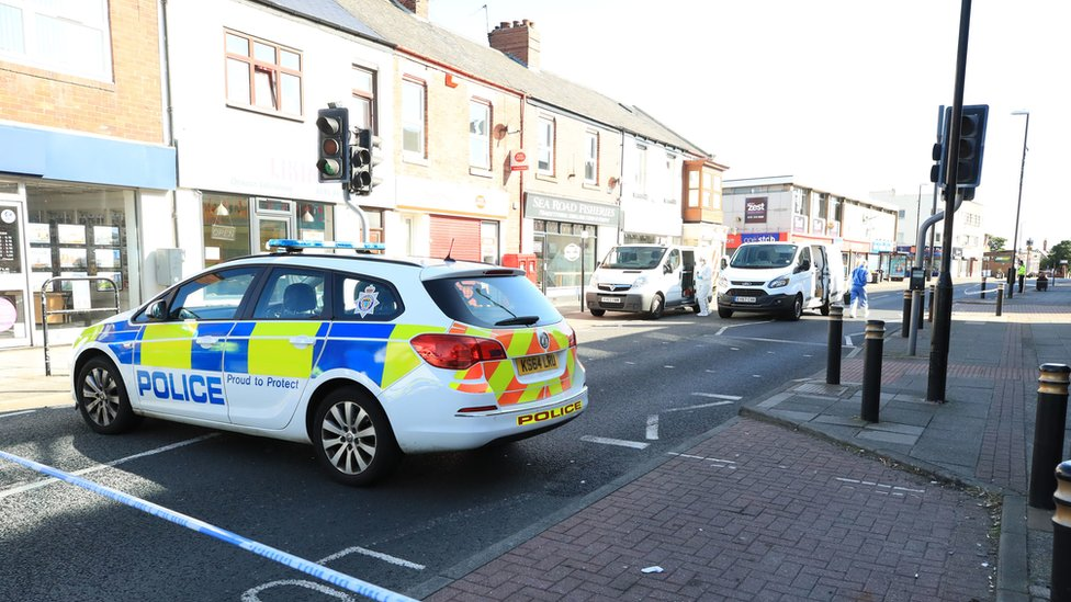 Police vehicles and a cordon at Sea Road, Sunderland