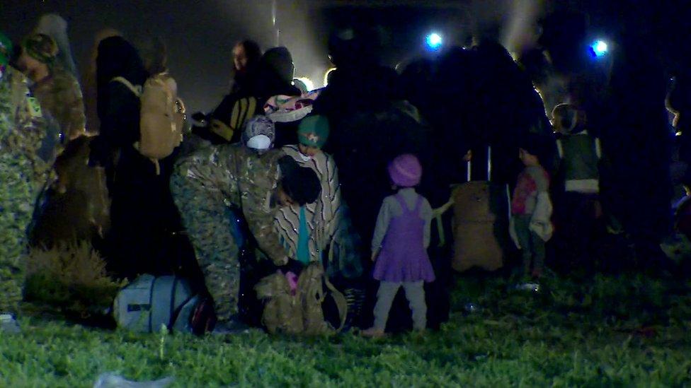 Mujeres y niños en el campo de refugiados