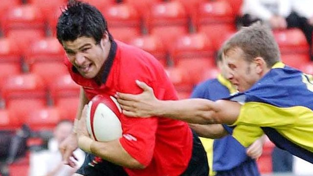 Mike Phillips takes on Romania on his Wales debut in 2003