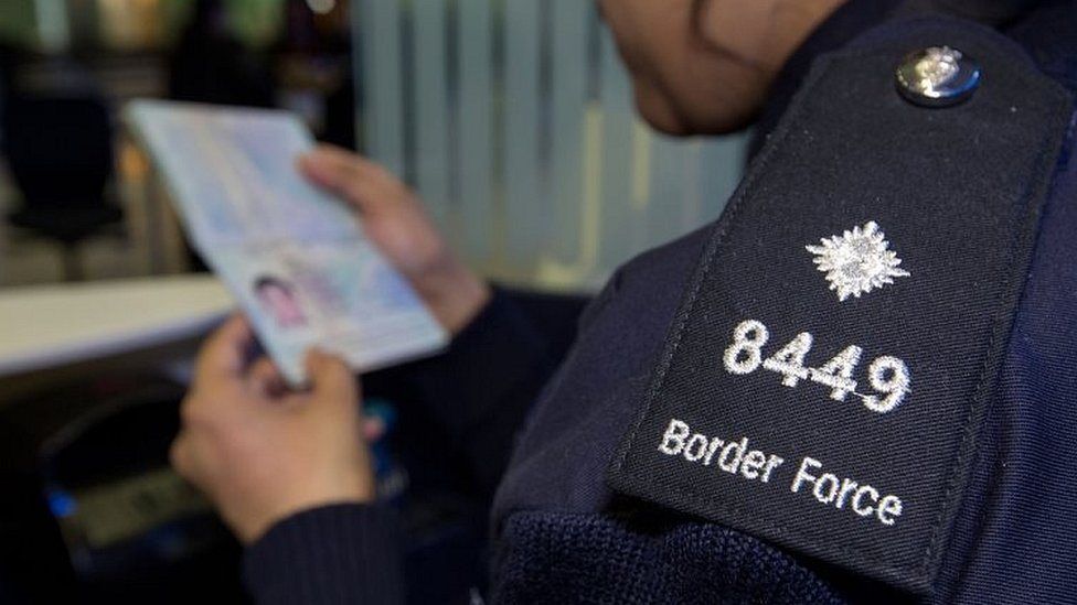 File pic from 2014 of a passport being checked