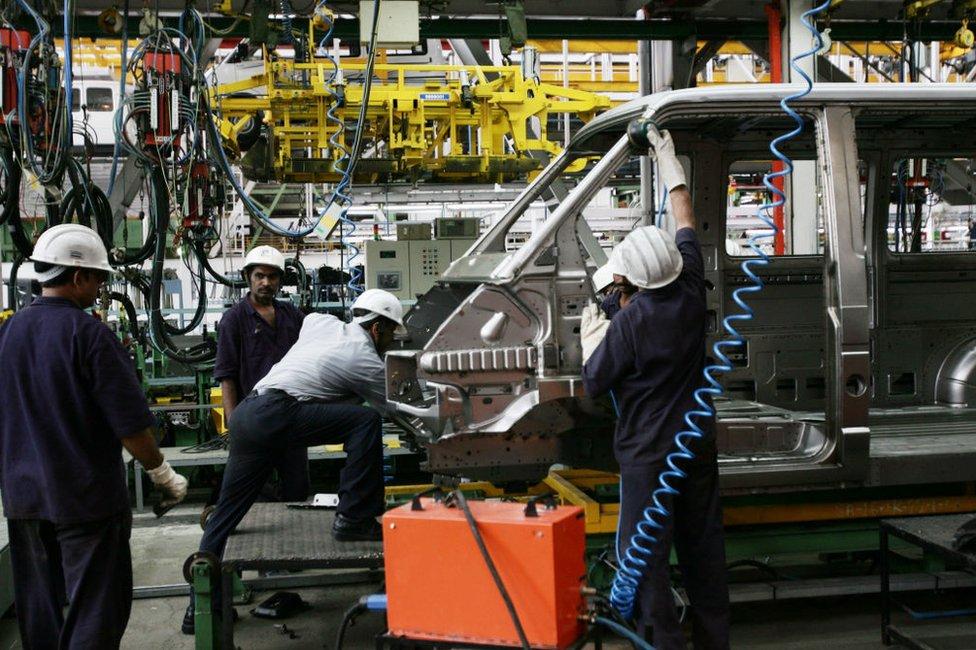 Workers at a Tata Motors assembling plant in Pimpri, India.