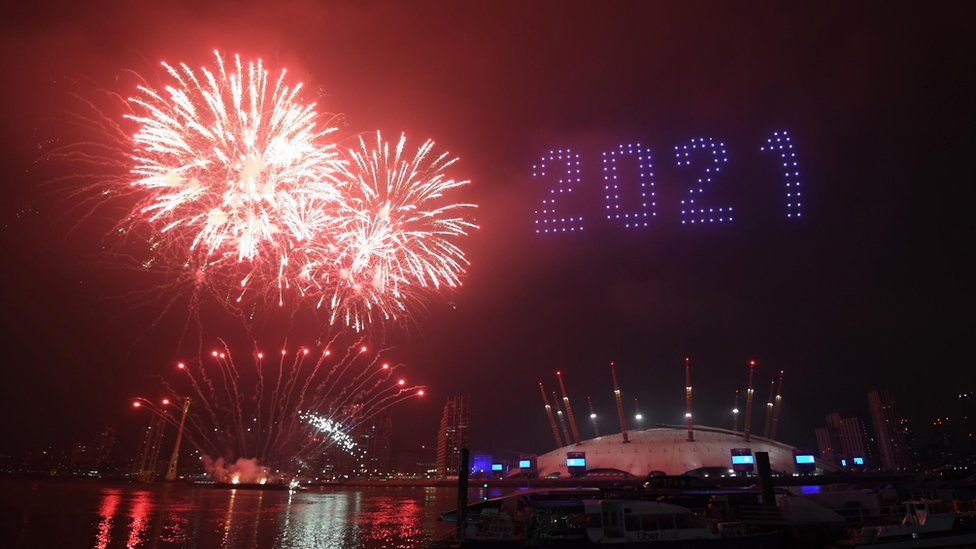 """Fireworks and drones illuminate the night sky over the The O2 in London as they form a light display as London""""s normal New Year""""s Eve fireworks display was cancelled due to the coronavirus pandemic."""