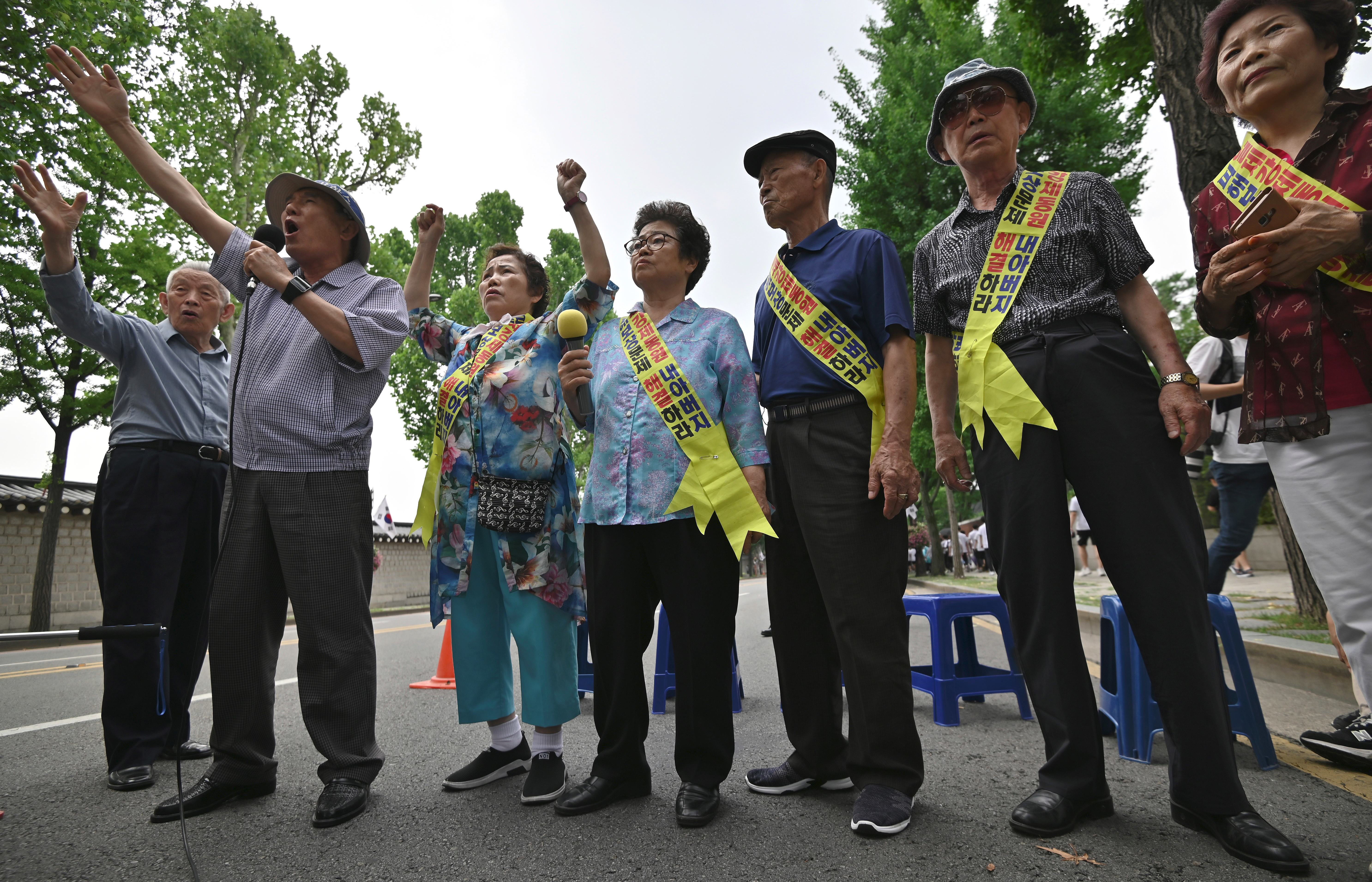 Family members of South Korean victims of forced labour by Japan during World War Two, participate in a rally urging resolution of compensation in Seoul on 16 July