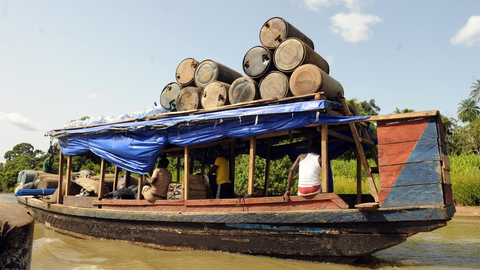Illegal oil is ferried to market in the Niger Delta in April 2013
