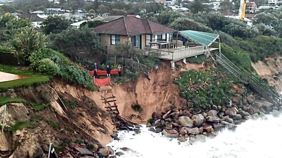 A beachfront home affected by the high waves in Warambel
