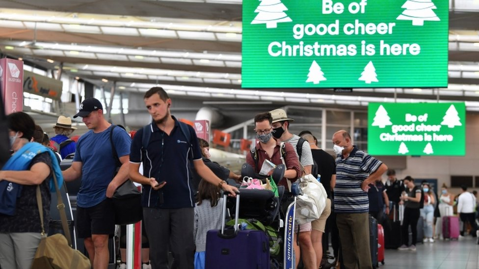 Long lines of passengers are seen trying to depart Sydney Domestic Airport in Sydney, Australia