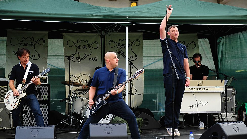 The Inspiral Carpets perform during the NatWest Womens' International T20 between England and West Indies at Old Trafford on September 10, 2012 in Manchester