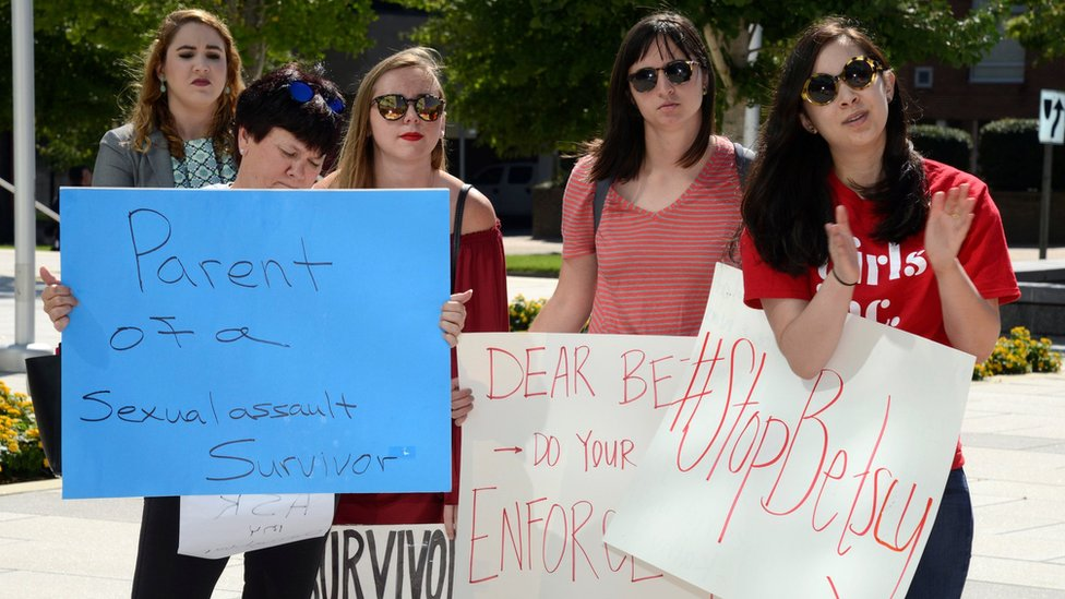 Demonstrators gathered as Education Secretary Betsy DeVos prepared to speak at George Mason University in Arlington, Virginia, on 7 September 2017