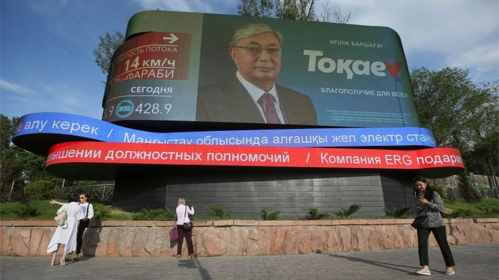 A screen shows an image of Kazakh President and candidate Kassym-Jomart Tokayev, which is part of his campaign ahead of the upcoming presidential election, in Almaty, Kazakhstan June 3, 2019.