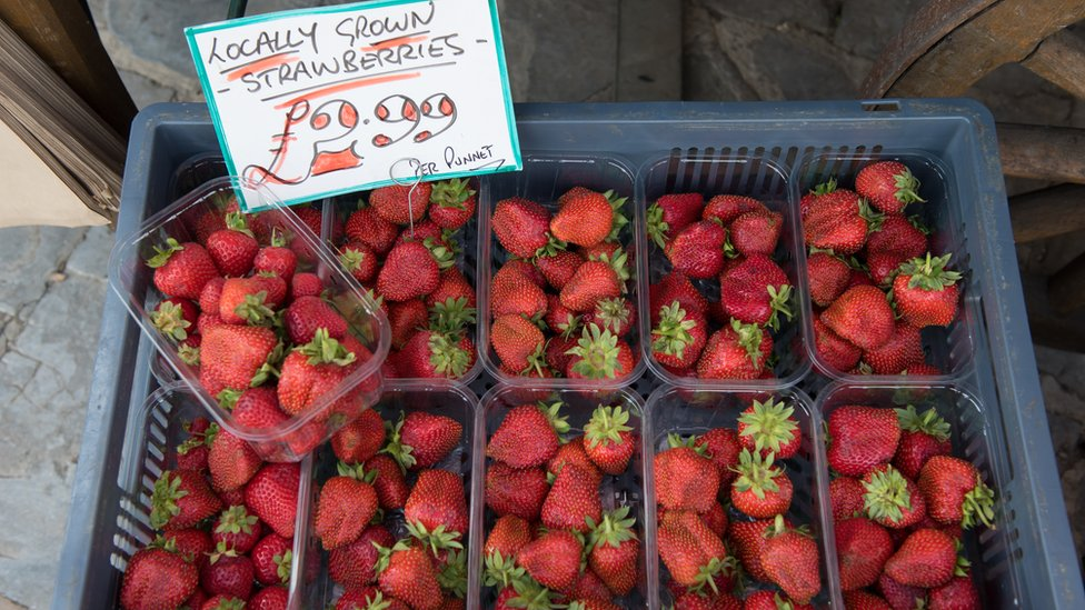 Strawberries being sold at a market