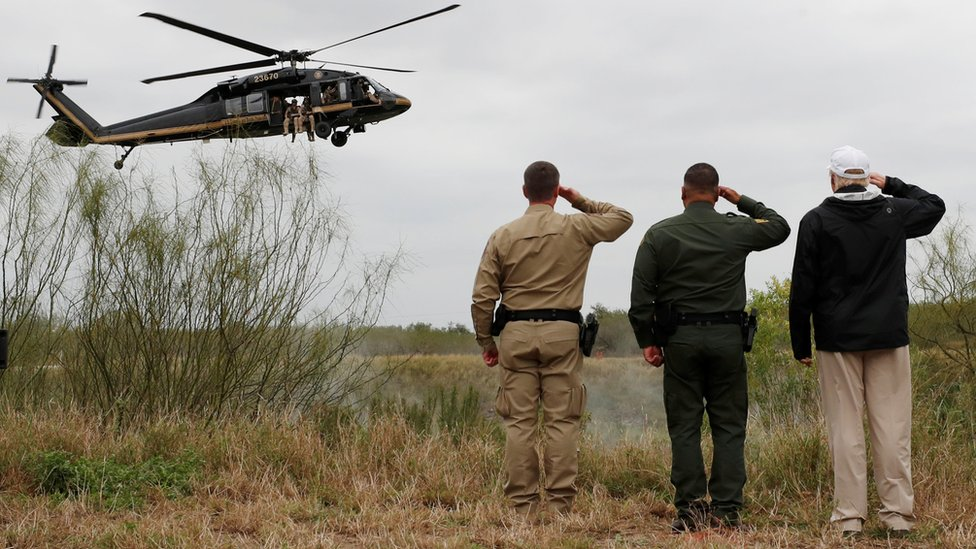 President Trump salutes a US Border Patrol helicopter in Mission, Texas, 10 January 2019