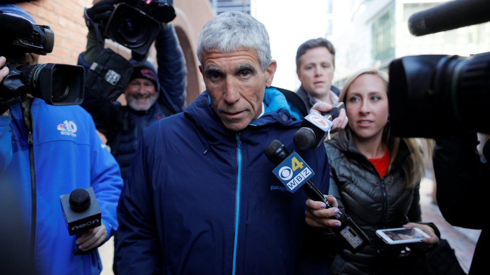 """William """"Rick"""" Singer leaves the federal courthouse after facing charges in a nationwide college admissions cheating scheme in Boston, Massachusetts"""