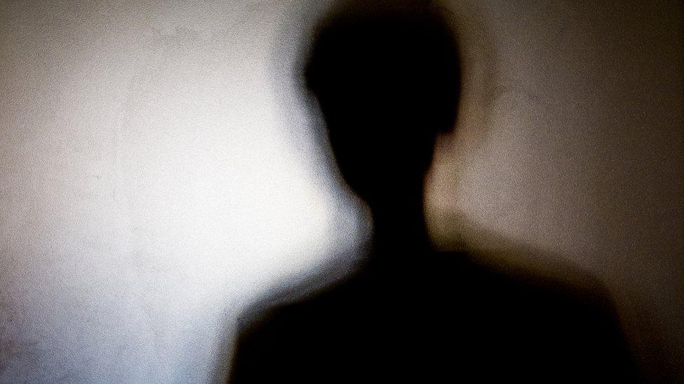Sombra de una mujer